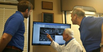 Dental Implant Doctors reviewing xrays